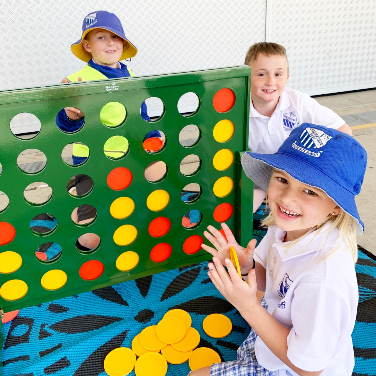 Kids playing giant connect 4 game